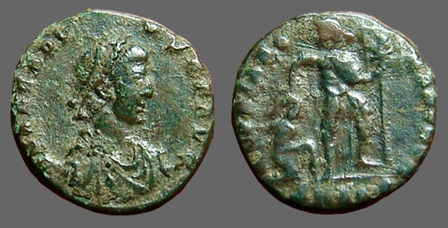 Ancient Coins - Arcadius AE3 Emperor grabbing barbarian by hair, holds labarum in left hand